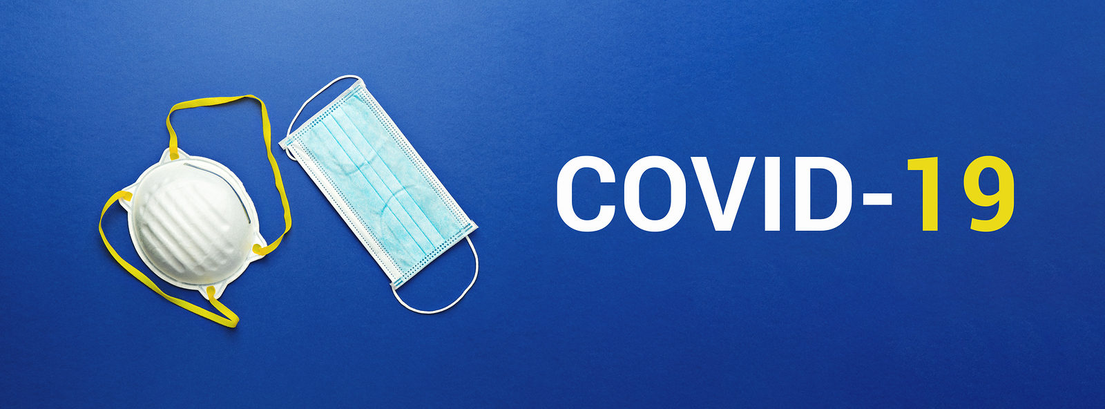 Two types of protective face masks on blue background with inscription COVID-19. Protective masks as precaution in spread of coronavirus Covid-19 around world, banner, flat lay